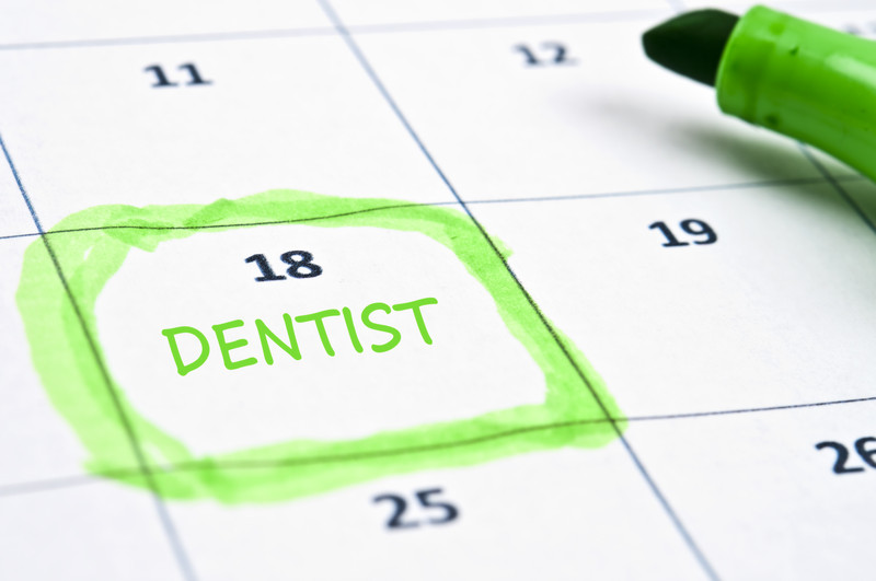 Zoomed image of a calender marked with dentist